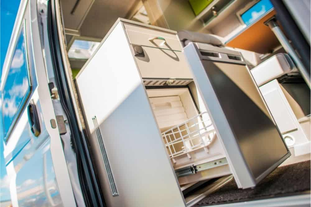 How do I keep my RV fridge cold while driving?